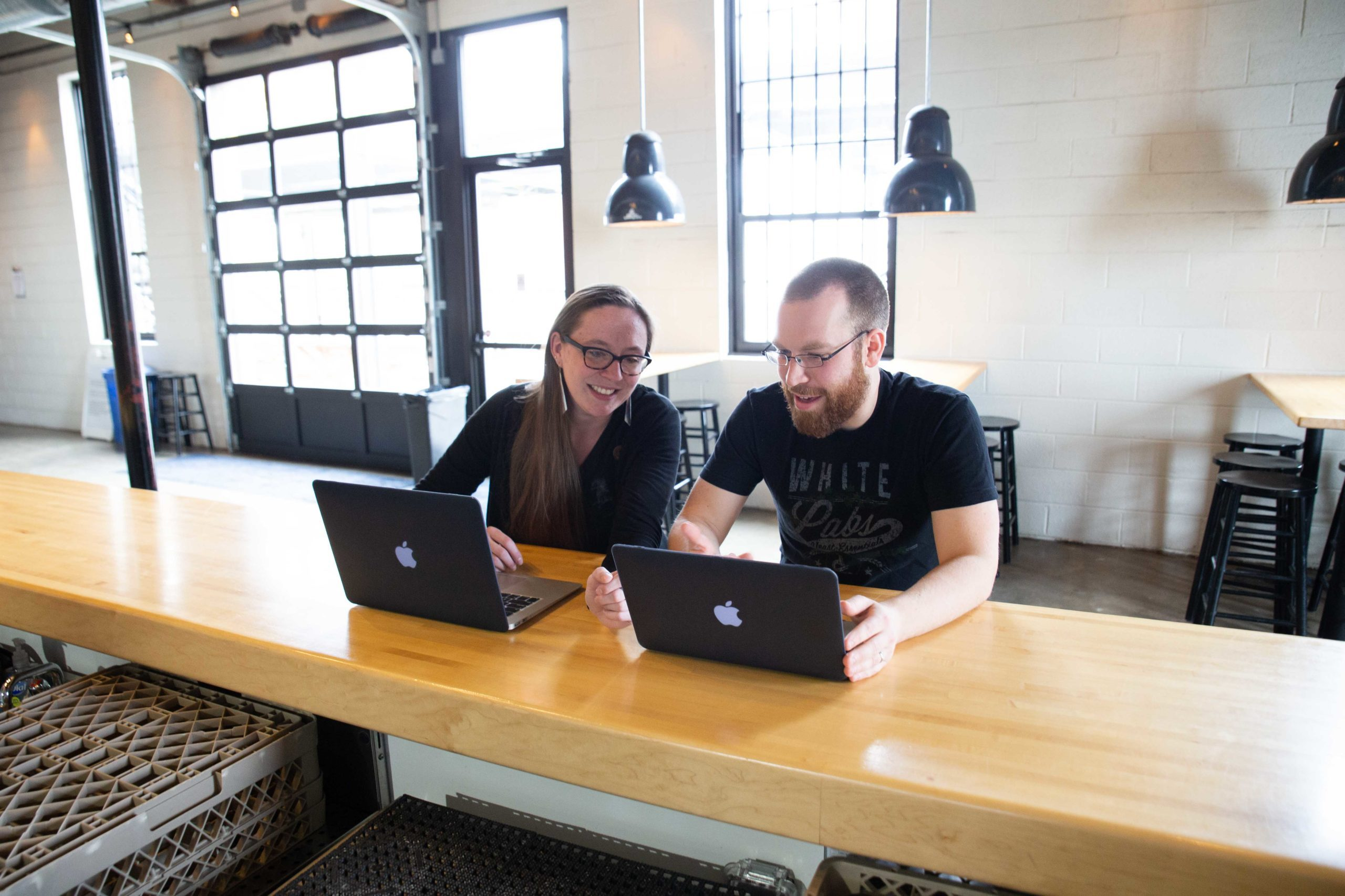 brewery employees using computers